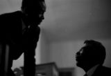 Thumbnail for William M. Branch speaking to a man during a meeting at First Baptist Church in Eutaw, Alabama.