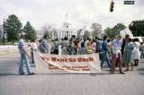 Demonstrators standing in front of the Capitol in Montgomery, Alabama, to protest President Ronald Reagan's visit to the state legislature.