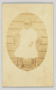 Thumbnail for Photographic postcard featuring an oval portrait of a young child