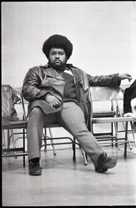 Huey P. Newton speaking at Boston College: Party member in chair