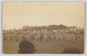 Photographic postcard of a military marching band