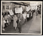 """C.L. Dellums stands in picket line holding sign, """"Negro kids are going to jail trying to eat at Woolworth and Kress"""""""