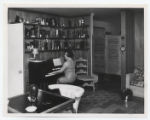 Elreta Alexander at piano in her home