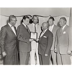 Attorney Henry Smith receiving an NAACP certificate from Dr. Chester Harris, Dr. Ralph Hadley, Dr. Charles Cephas, Dr. McKinley King and Dr. Max Johnson