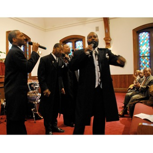 Richard Brown watches four unidentified members of the Peoples Baptist Church congregation perform.