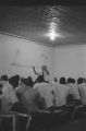 Parchman Penitentiary: Electric chair, men singing, minister preaching, prison vehicle logos (PPP B-68 #1178)