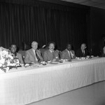 Black Business Association luncheon participants posing while at a table, Los Angeles, 1973