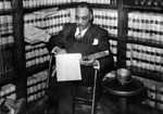 Walter Gordon, Jr. reviewing a case