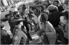 African American crowd and police officers during a civil rights march in Social Circle, Georgia, February 20, 1982.