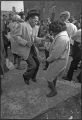 Man and woman dancing on Peoria Street