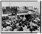 [Passengers climb from rear of streetcar stopped by mob during race riots in Detroit, Michigan]