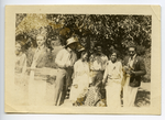 Six people standing in field, Farmersville, California