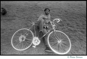 African American man lying of the ground with his bicycle, near 181 Vicente Street