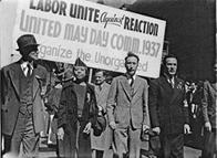 Edith Ransom and Charles Zimmerman (center) of ILGWU Local 22 march with others in the 1937 May Day parade