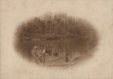 Three African American men operating a ferry as it carries a horse-drawn carriage and driver across the Cahaba River.