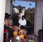 Berry Gordy with children at his house party, Los Angeles