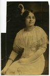 Portrait of Pearl Roberts seated wearing white dress and gloves