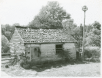 Former slave quarters now used as milk house on farm near Bardstown, Kentucky, August 1940