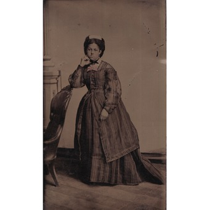 An African-American woman in a striped dress.