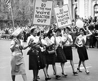 "ILGWU women marching in a Labor Day parade with placards that read, ""'60 is the year to vote reaction out."""