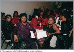 Guests posing for photos at Christmas Kwanzaa soiree Christmas/Kwanzaa Soiree