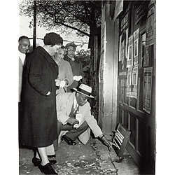 Mr. Young demonstrating voting machine to Florence Williams and another woman, possibly Teenie Harris' cousin