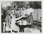 Crew members of the USS Lake Champlain (CVA-39) participating in the ship's two day blood drive, with the crew pledging to make a quota of 1000 pints
