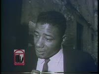 WSB-TV newsfilm clip of former heavyweight boxing champion Floyd Patterson speaking to a reporter about the civil rights movement in Birmingham, Alabama, 1963 May 9