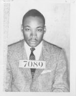 Mississippi State Sovereignty Commission photograph of Martin Luther King, Jr. after an arrest with a slate around his neck bearing the the booking number 7089, Montgomery, Alabama, 1956 February