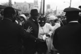 Mahalia Jackson and others on Auburn Avenue, just west of Ebenezer Baptist Church on the day of Martin Luther King, Jr.'s funeral.