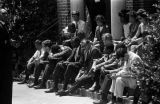 Students and faculty from Tuskegee Institute seated on the front steps of Tuskegee Methodist Church, after a failed attempt to desegregate the congregation.