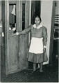 Two maids at telephone booth