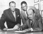 W. H. Coffin signs NAACP proclamation with Earl Erne and John J. Mance
