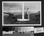 Harrison Gray Otis standing by war memorial near Los Angeles Harbor