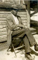 Unidentified man, seated with cigar