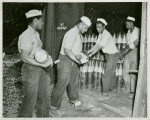 U.S. Navy African American enlisted members placing six-inches-shells in magazines at the Naval Ammunition base