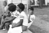 Young women seated on a bench during a women's softball game.