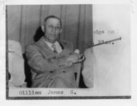 """Mississippi State Sovereignty Commission photograph of James C. Gilliam pinned to a piece of paper that lists his name and reads """"Grand Master of Lodge on Lynch Street, Jackson, Mississippi"""", 1950s"""
