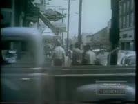 BLACK DEMONSTRATORS REMOVED BY TROOPS PATROLLING TOWN (1963)