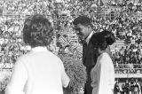 Muhammad Ali on the football field with the mascot and cheerleaders from Tuskegee Institute during homecoming activities for Alabama State College on Thanksgiving Day in Montgomery, Alabama.