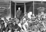 Students from Tuskegee Institute seated on the sidewalk outside the Alabama Novelty House store, during a demonstration to protest the murder of Samuel L. Younge, a civil rights worker.