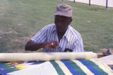 Robert Sills sewing a quilt at the 1990 Alabama Folklife Festival in Birmingham, Alabama.