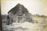 African American woman and child outside of cabin