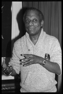 James Baldwin: informal portrait, gesturing, at the book party for Robert H. Abel