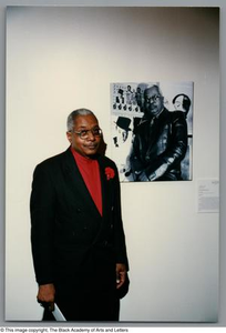 Allison Tucker standing in front of his portrait Dallas/Fort Worth Black Living Legends