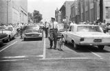 Thumbnail for Police officer walking a dog down the center of the street during the Children's Campaign in Birmingham, Alabama.