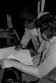 Woman signing a petition requesting Johnny Coleman's release from prison, during a meeting at First Baptist Church in Eutaw, Alabama.