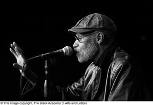 Photograph of a closeup of director Melvin Van Peebles speaking into a microphone, 4