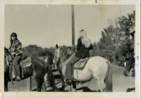 Several Individuals Riding Horses