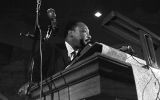 Martin Luther King, Jr., speaking to an audience at St. Paul AME Church in Birmingham, Alabama.